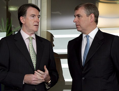 Prince Andrew, Duke of York (R) is welcomes by  European Trade Commissioner, British, Peter Mandelson